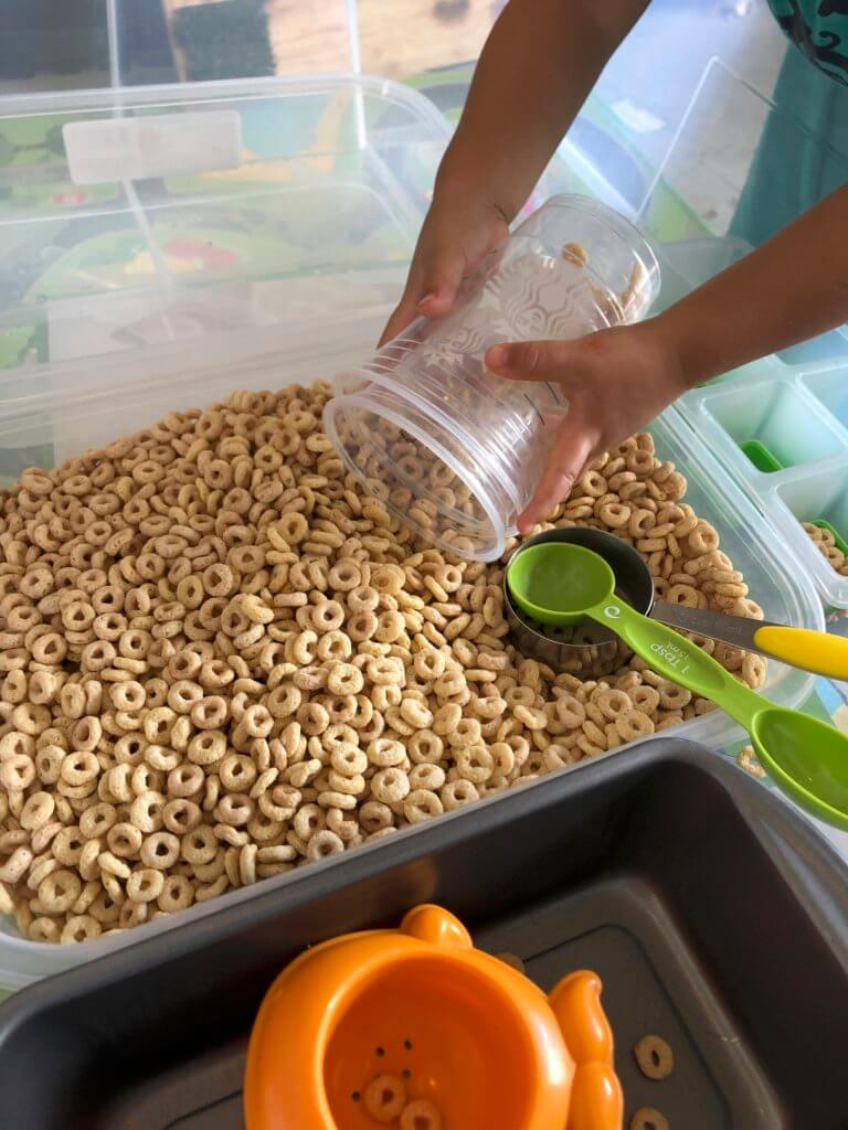 cereal sensory play can be a great game to practice on fine motor skills.